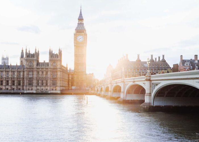 Let me show you London - sun sets over big ben and the houses of parliament with the river thames in foreground