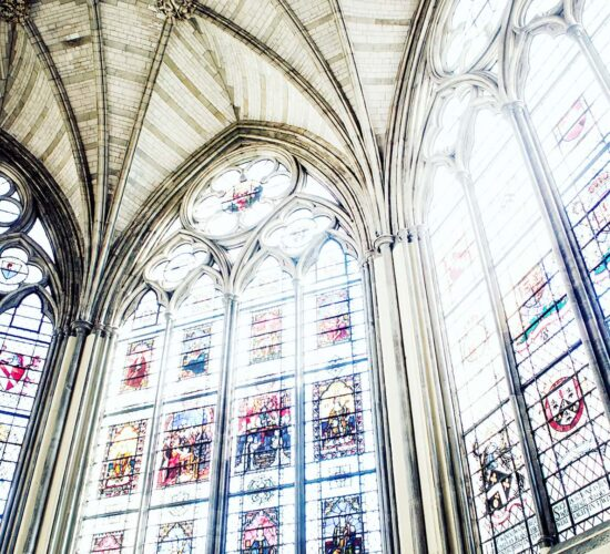 Westminster Abbey tour with Let me show you London - view of stained glass windows with light streaming in