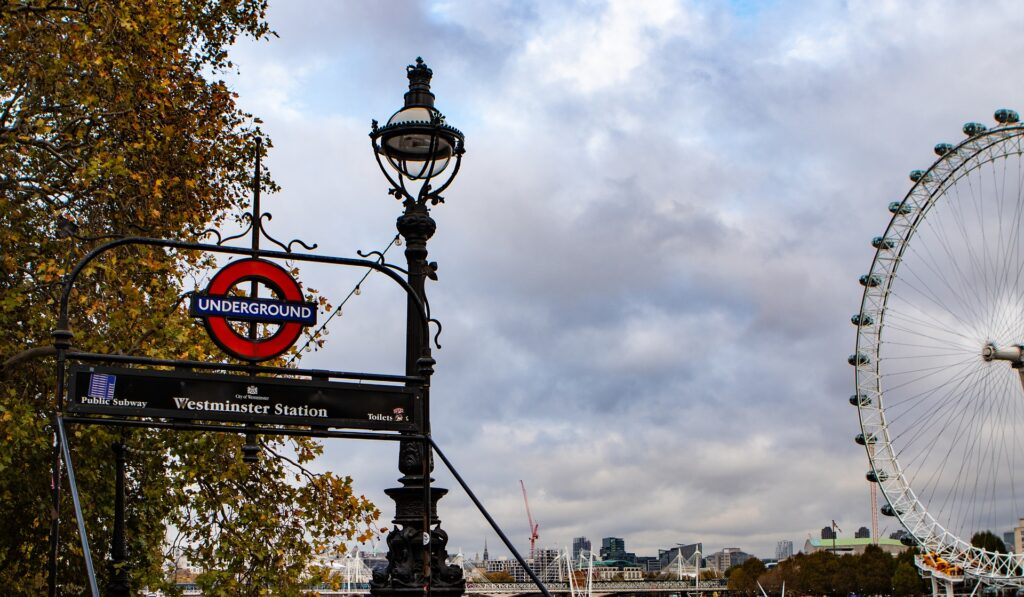Westminster underground station with a view of London Eye and skyline