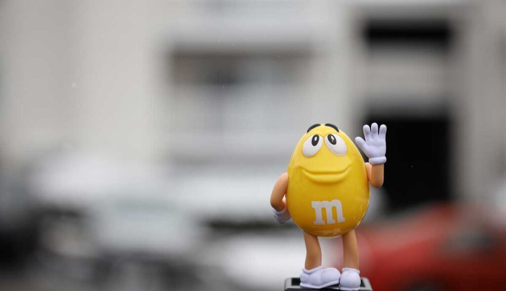 M&M's yellow character waving outside London flagship store