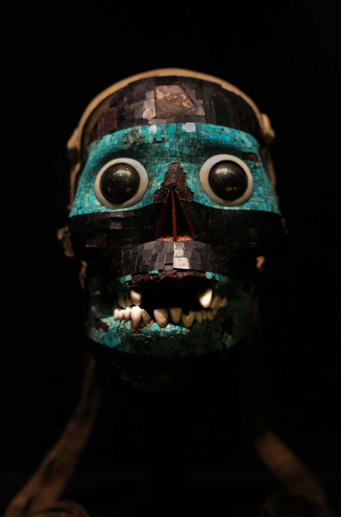 Colourful Aztec mask in the Aztec gallery at the British Museum