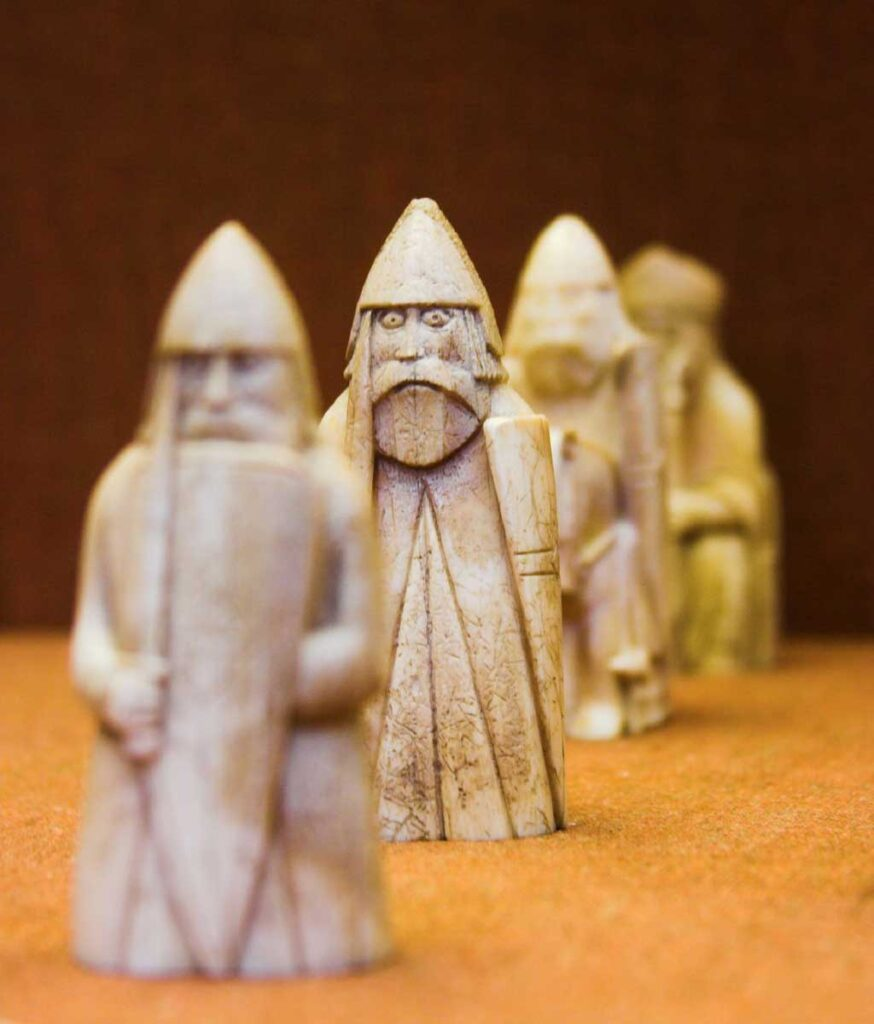 small carved norsemen chess pieces known as the Lewis Chessmen at the British Museum